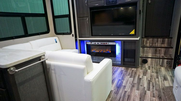 toy_hauler_5th_wheel_4250W_entertainment_fireplace.jpg